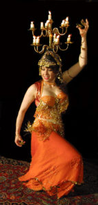 NImeera Nazmine performing with a shamadan (candle headdress); photo courtesy Washington Post.